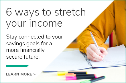 Hand writing in a notebook, with text describing 6 ways to stretch income for savings goals